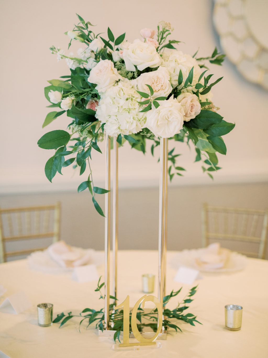 Timeless Romantic Wedding Reception Decor, Tall Gold Stand with Greenery and White, Blush Pink Roses and Hydrangeas, Gold Table Number and Votive Candles | Tampa Bay Wedding Planner Special Moments Event Planning | Wedding Rentals Kate Ryan Event Rentals