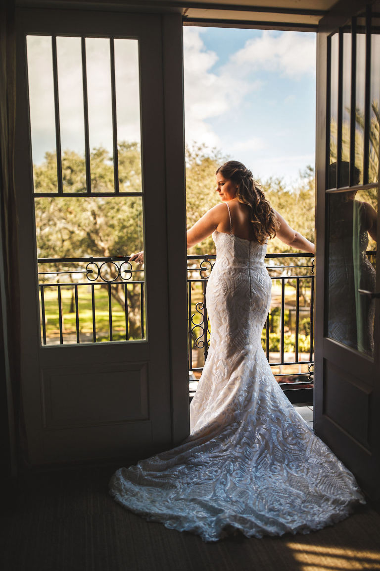 Tampa Bride on Balcony of Hotel Wearing Casablanca Bridal Lace Fit and Flare Wedding Dress | St. Pete Wedding Venue The Birchwood