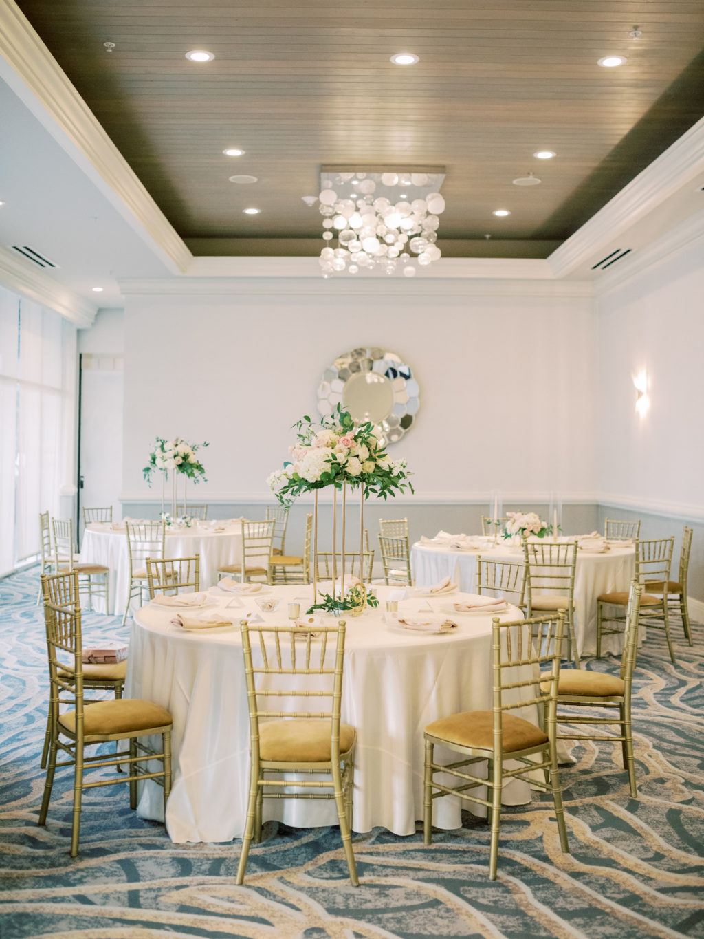 Timeless Romantic Wedding Reception Decor, Round Tables with White Linens, Gold Chiavari Chairs, Blush and Ivory with Greenery Floral Centerpieces | Wedding Venue Hyatt Regency Clearwater Beach | Tampa Bay Wedding Planner Special Moments Event Planning | Wedding Rentals Kate Ryan Event Rentals
