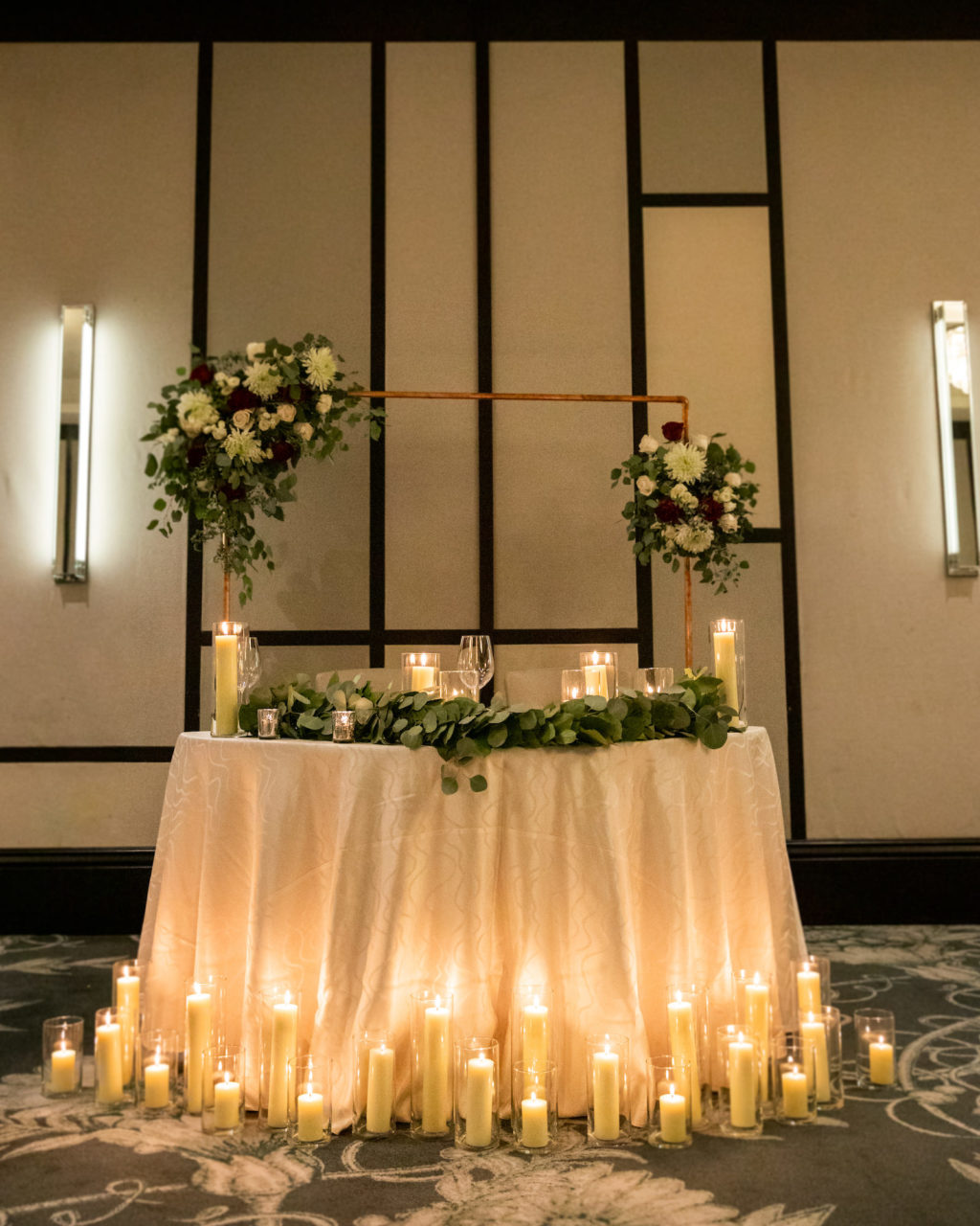 Elegant Timeless Wedding Reception Decor, Sweetheart Table with Ivory Linen, Candles, Greenery Eucalyptus Garland, Arch with Floral Arrangements | Tampa Bay Wedding Planner Elegant Affairs by Design
