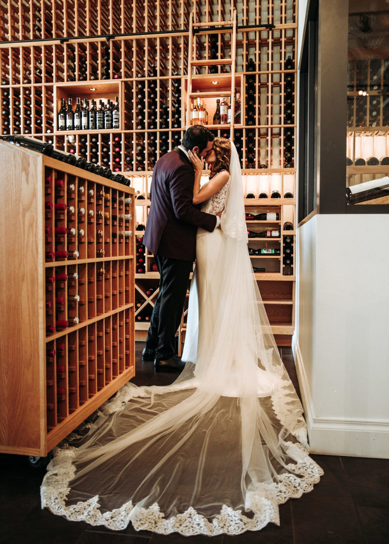 Florida Timeless Bride in Full Length Lace Trim Veil and Groom in Burgundy Tuxedo in Wine Cellar   Elegant Affairs by Design