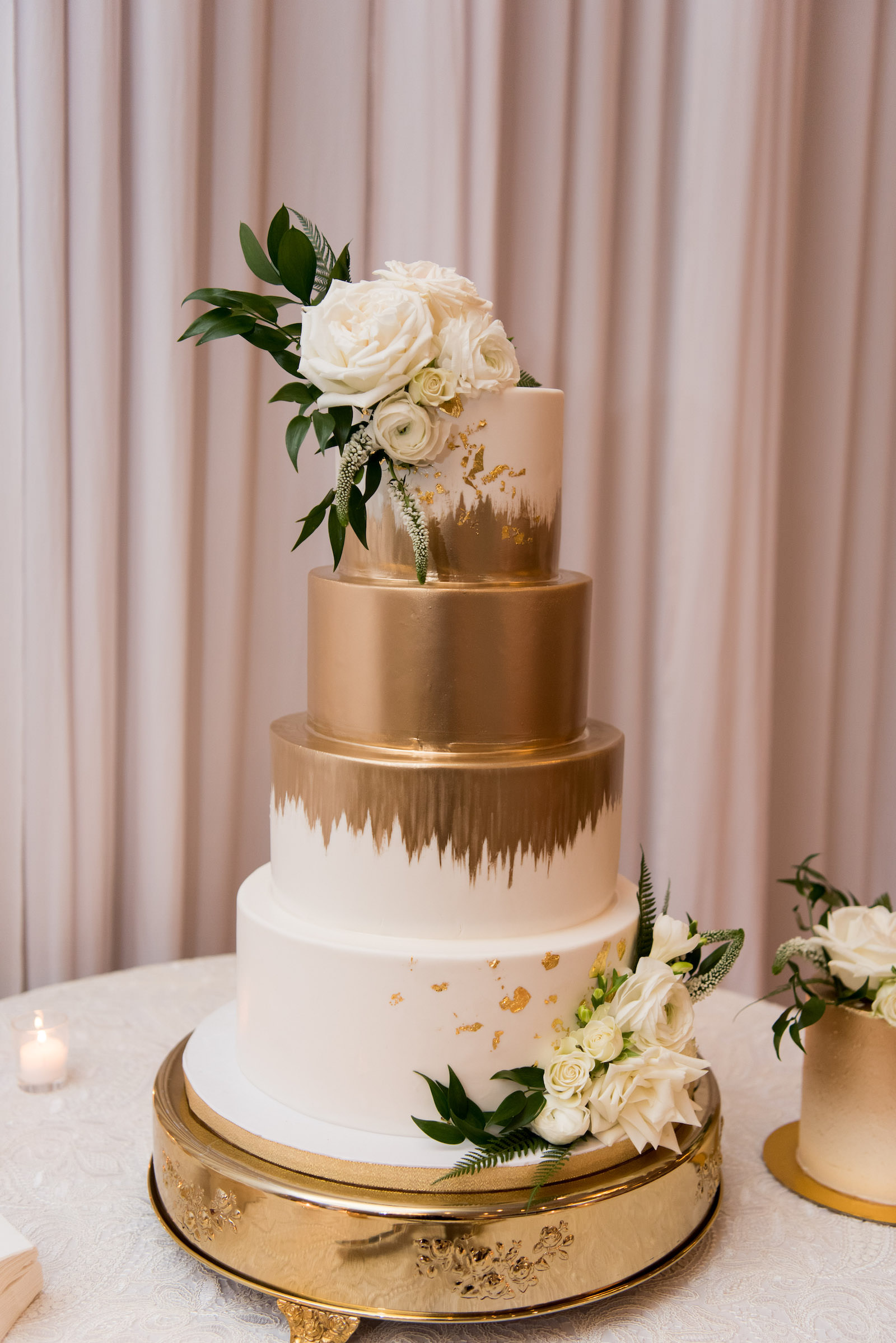 Elegant Classic White and Gold Painted Four Tier Wedding Cake with White Roses | Tampa Bay Wedding Baker The Artistic Whisk | Wedding Florist Bruce Wayne Florals | Tampa Bay Wedding Planner Parties A'la Carte