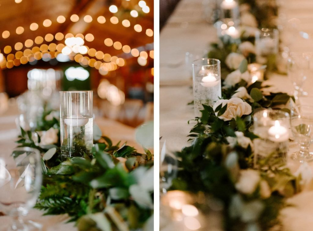 Long Feasting Tables with White Linens and Rose and Eucalyptus Greenery Garland Centerpieces with Floating Candles under a Canopy of String Lights