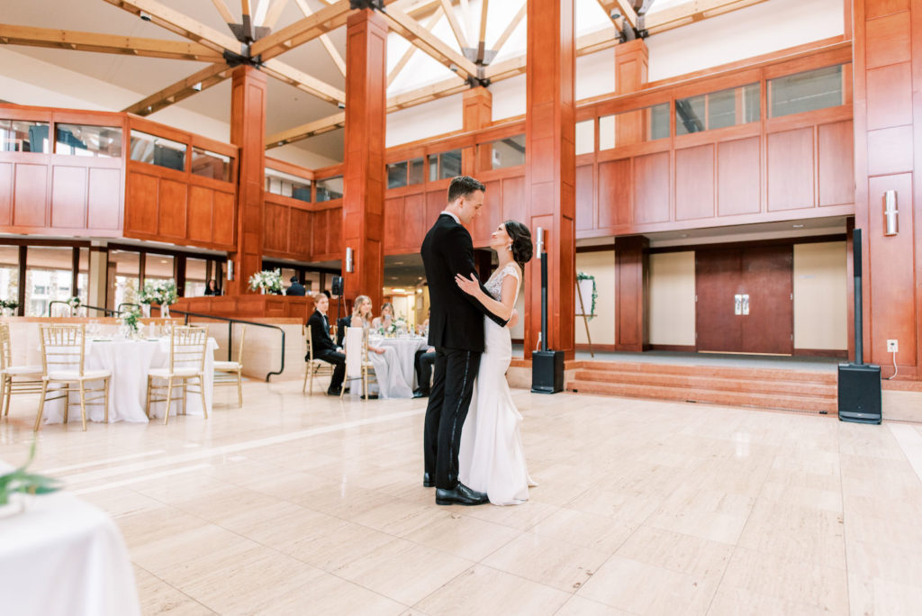Bride and Groom First Dance | Modern Minimal Wedding Reception Decor, White Tables with Gold Chiavari Chairs | Tampa Bay Wedding Photographer Kera Photography | St. Pete Wedding Venue Poynter Institute | Wedding DJ Graingertainement