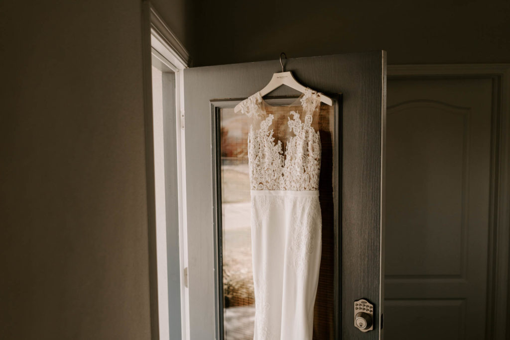 Bridal Gown Wedding Dress Hanger Shot | Illusion Lace Bodice Sheath Wedding Dress