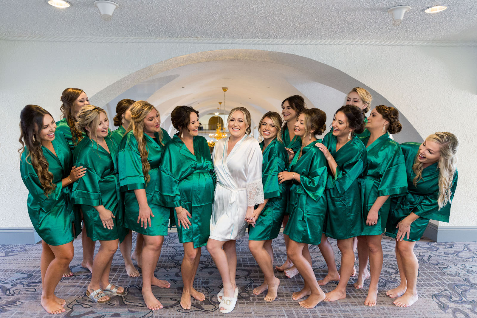 Bride in White Getting Ready Robe, Bridesmaids in Emerald Green Robes