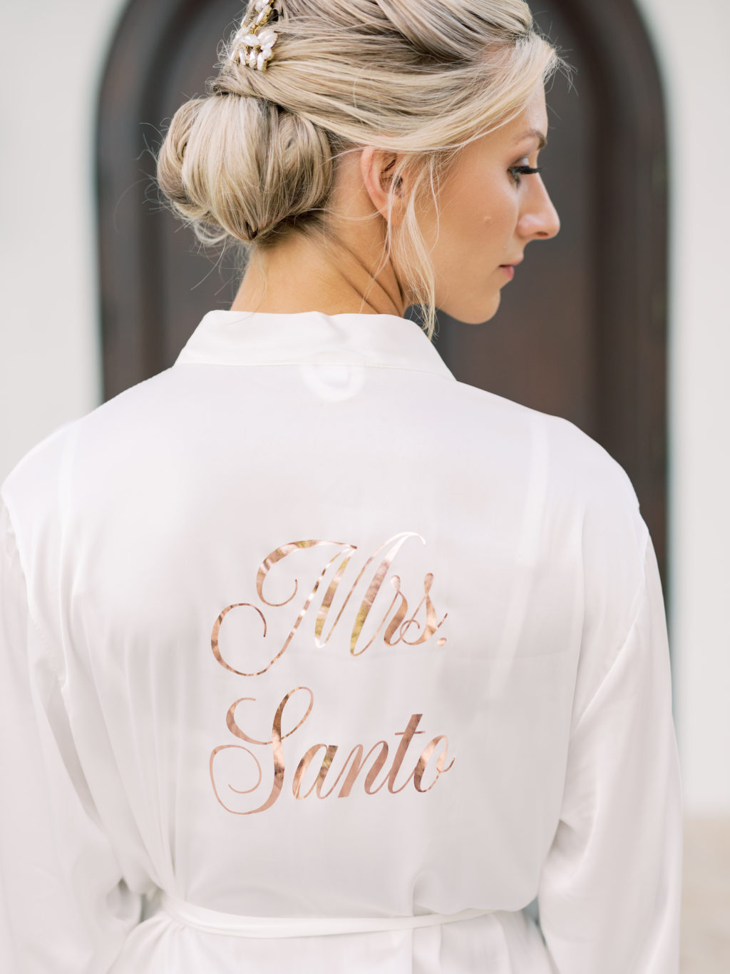 Tampa Bay Bride in White and Rose Gold Font Mrs Robe with Hair in Bun and Pearl Hair Piece | Tampa Bay Wedding Hair and Makeup Femme Akoi Beauty Studio