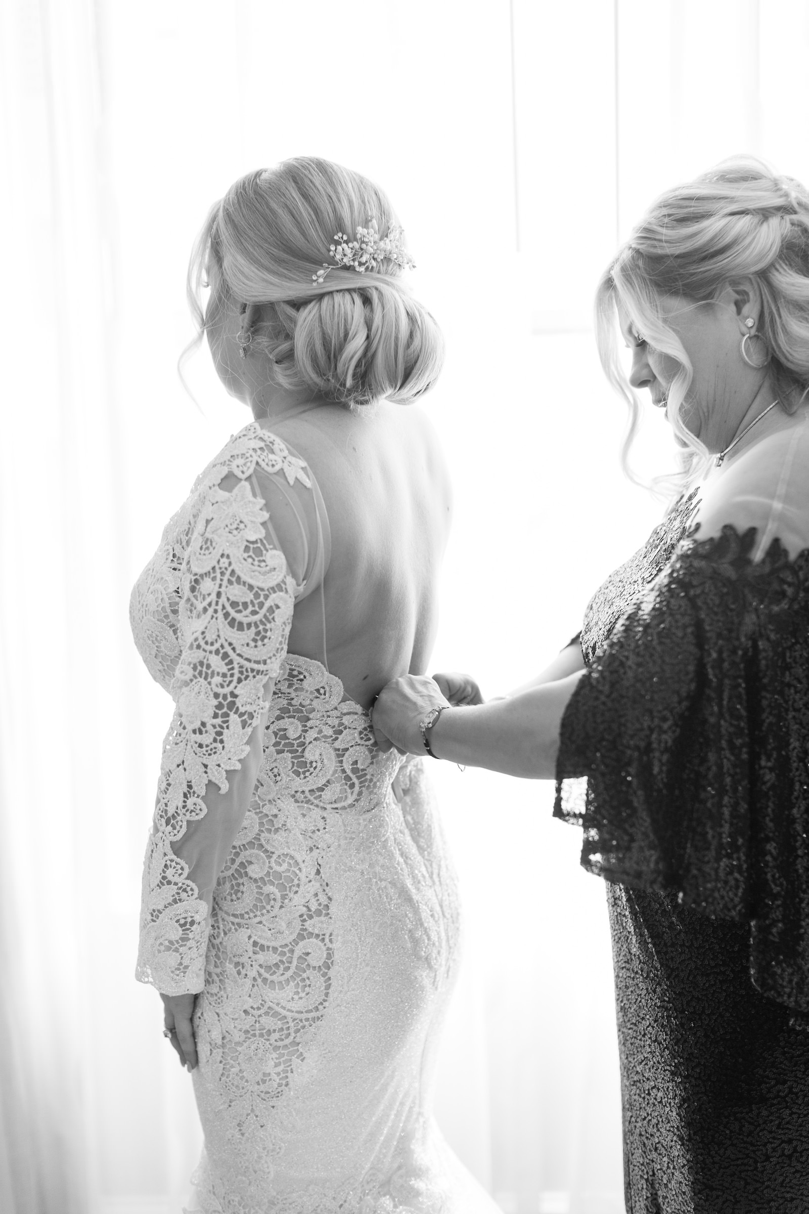 Bride Getting Ready in Lace and Illusion Open Back Wedding Dress