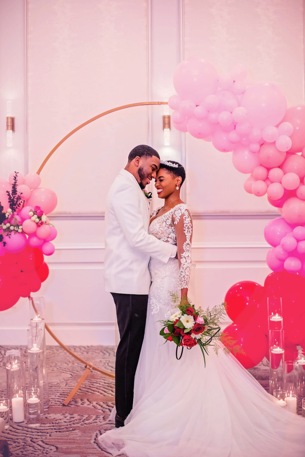 Bride and Groom Wedding Portrait with Wedding Ceremony Arch with Pink and Red Ombre Balloon Arch Decor | EventFull Weddings