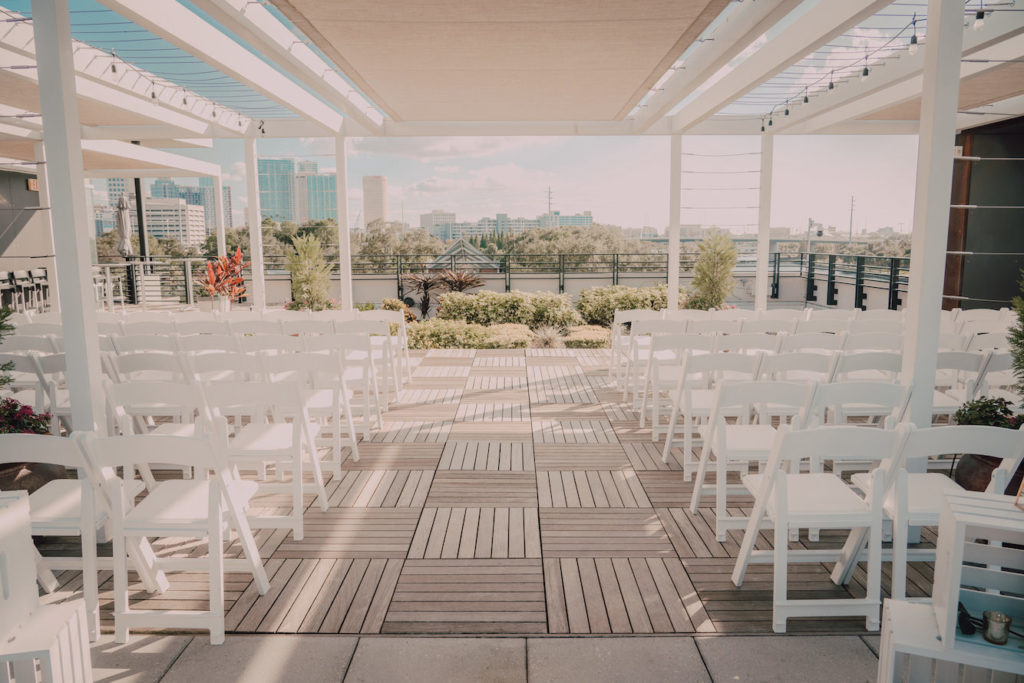 Tampa Heights Rooftop Wedding Ceremony at Rooftop 220 with white Garden Chairs | UNIQUE Weddings + Events