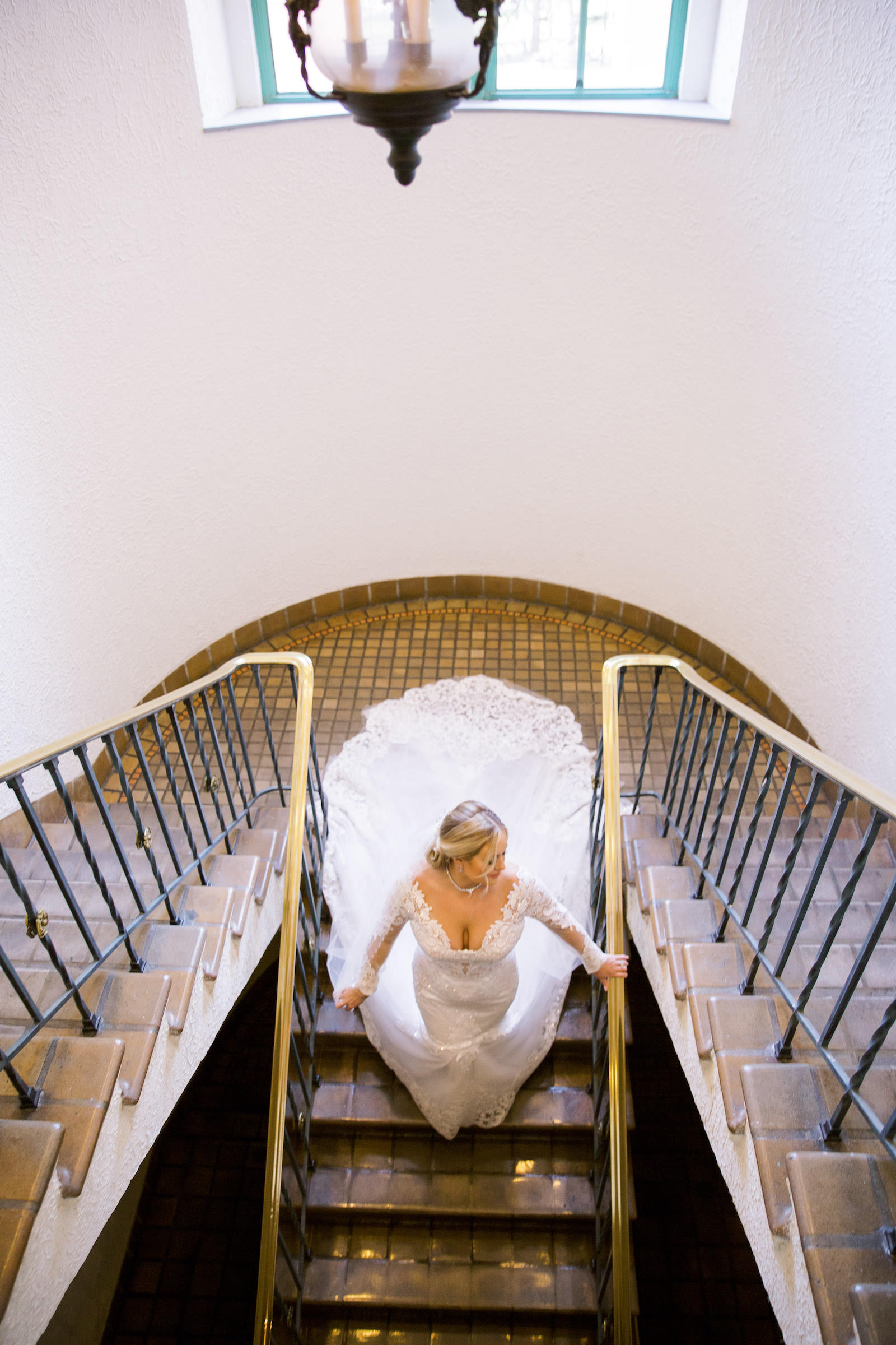 Creative Photo Looking Down on Bride on Staircase | The Vinoy