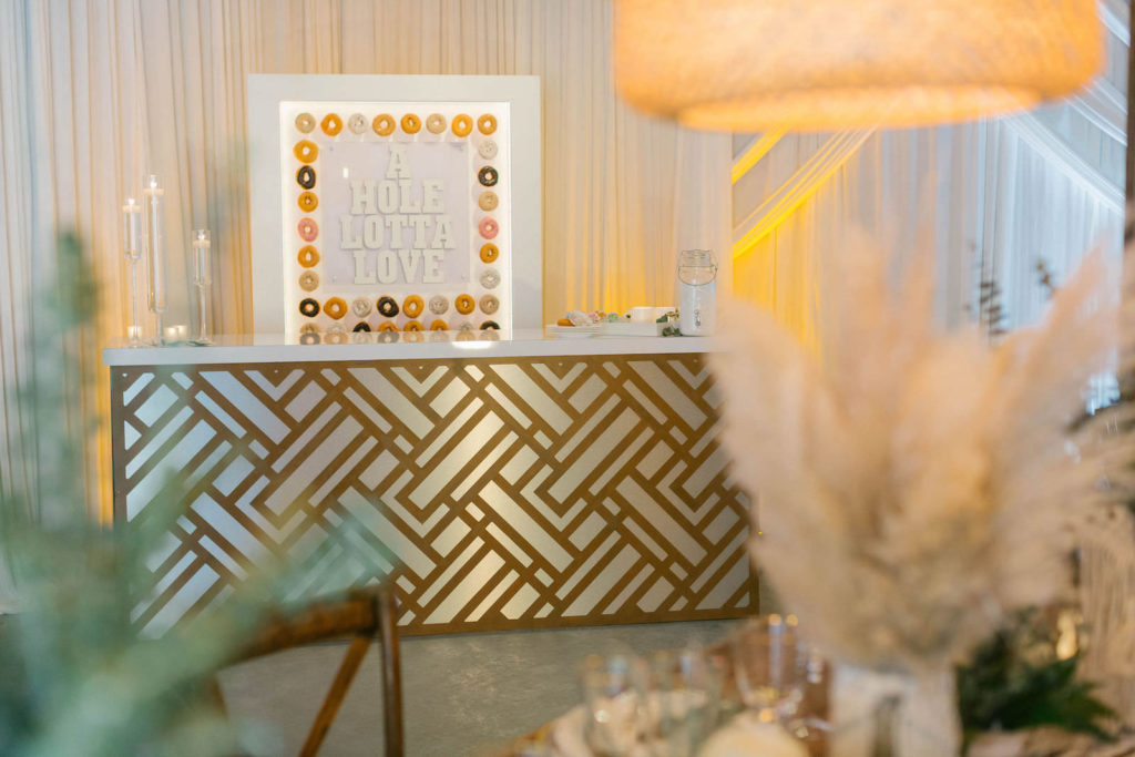 Modern Gold Bar Donut Station with Sign | Unique Reception Decor IdeasStyled | With Love at St. Pete Beach Wedding Venue Bellwether Beach Resort