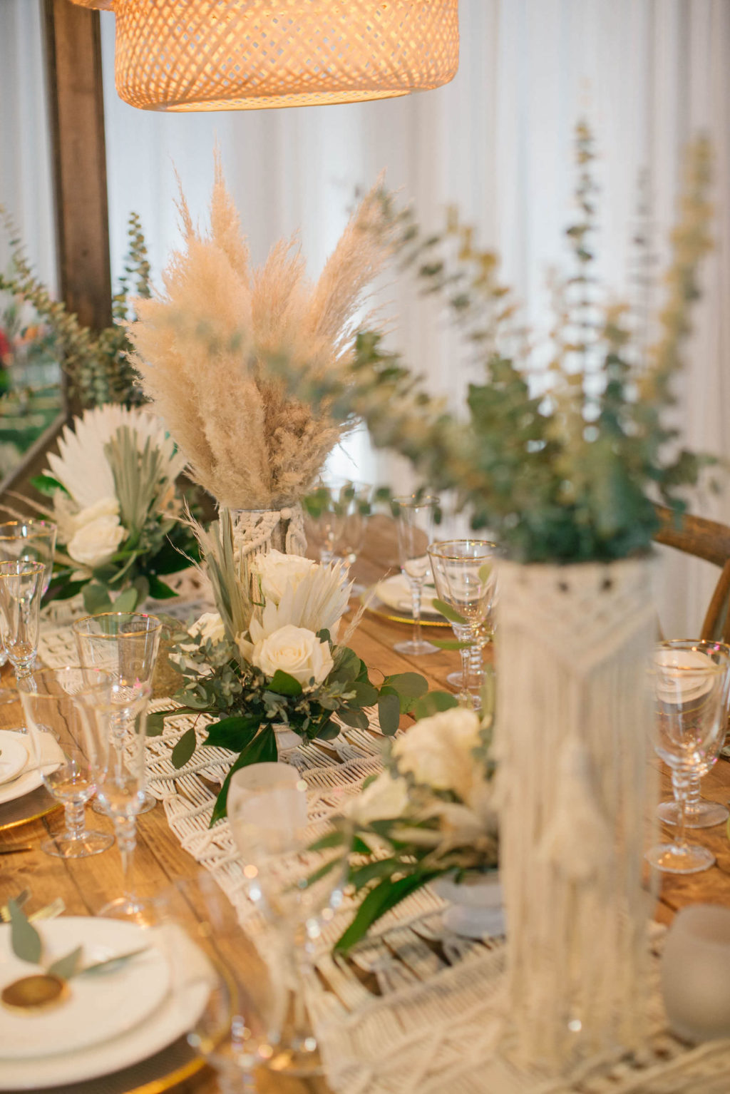Boho Pampas Grass and Eucalyptus Greenery Centerpieces with Macrame Table Runner | Reception Decor Ideas and Inspiration | Styled With Love at St. Pete Beach Wedding Venue Bellwether Beach Resort