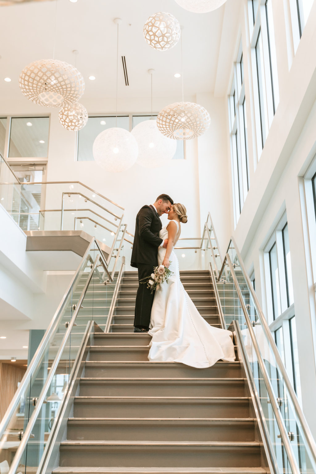 Bride and Groom Wedding Portrait on Staircase | Modern South Tampa Wedding Venue Aloft Midtown | Wedding Photographer and Videographer Bonnie Newman Creative | Wedding Dress Truly Forever Bridal