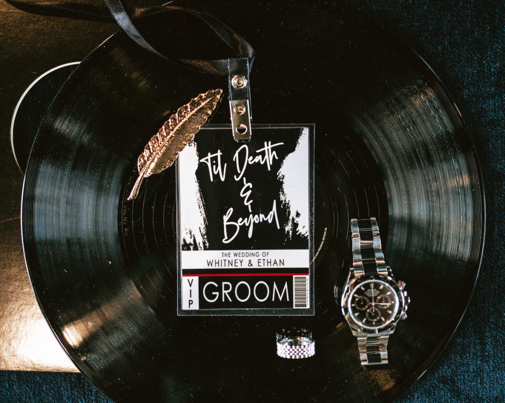 Edgy Urban Black VIP Concert Ticket Backstage Pass Style Wedding Invitation on Record, Gold Feather and Groom Accessories Watch and Ring | Tampa Bay Wedding Photographer Bonnie Newman Creative