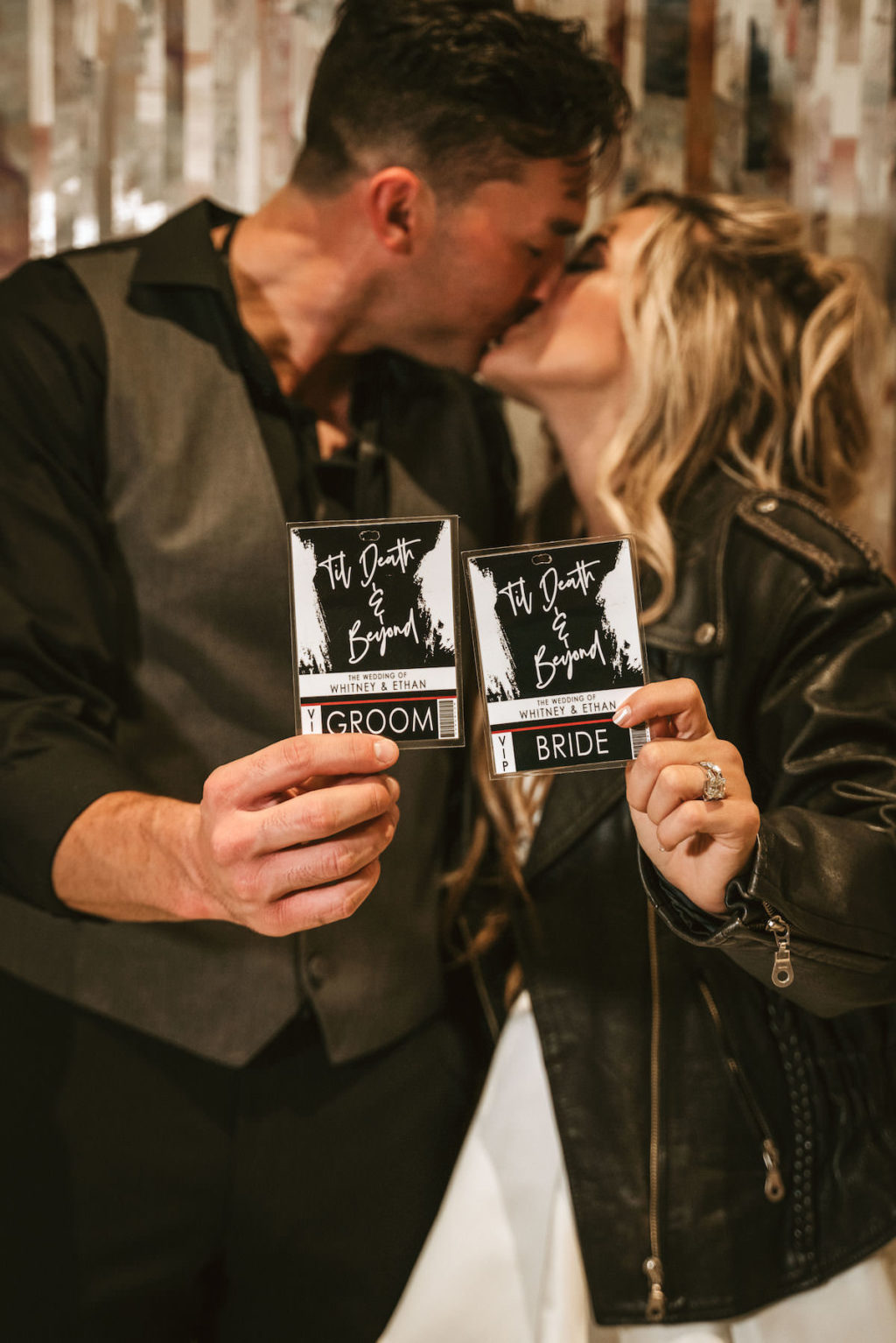 Urban and Edgy Bride in Black Leather Jacket and Short Wedding Dress with Groom in Black Dress Shirt and Pants and Gray Vest Holding VIP Black Backstage Concert Pass Style Wedding Invitations | Tampa Wedding Planner and Designer UNIQUE Weddings and Events | Wedding Photographer Bonnie Newman Creative