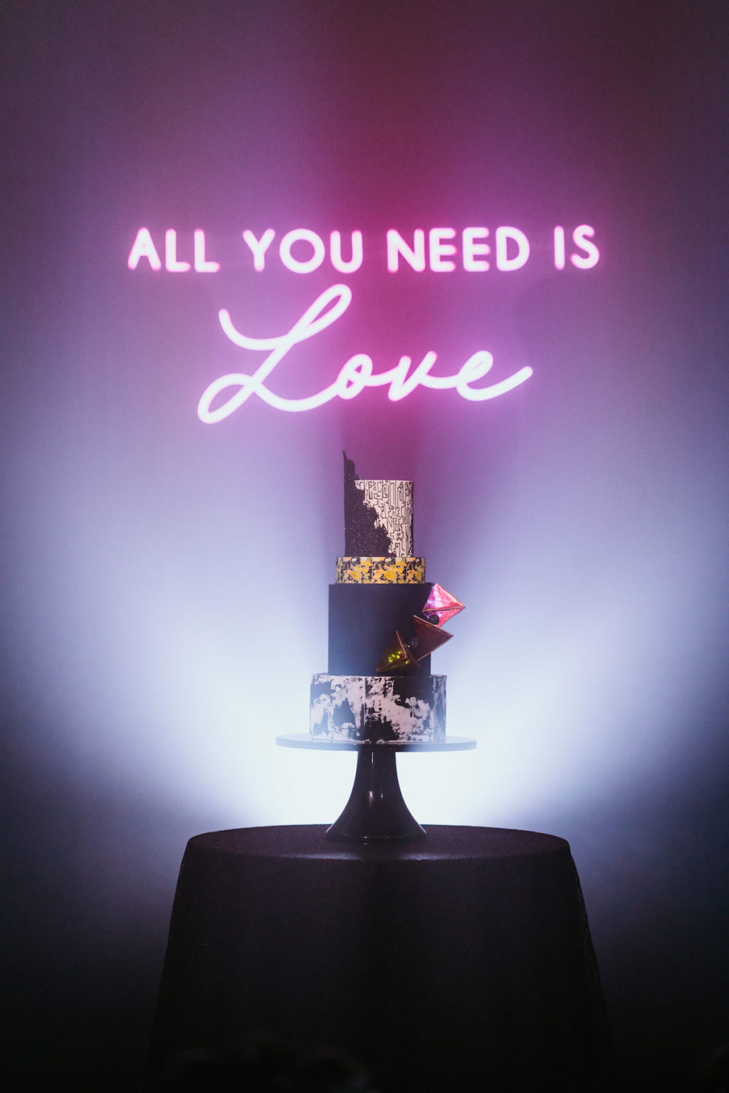 """Urban and Edgy Wedding Decor, Pink Neon Sign """"All You Need is Love"""", Four Tier Marble Black and Gold Wedding Cake 