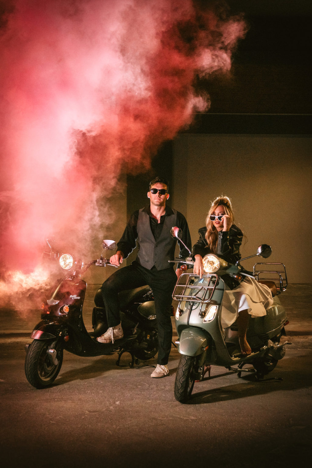 Urban and Edgy Bride in Leather Jacket on Silver Moto Scooter, Groom in Black Dress Shirt and Pants with Gray Vest on Black Scooter and Pink Smoke Bomb | Tampa Bay Wedding Photographer Bonnie Newman Creative | Wedding Designer and Planner UNIQUE Weddings + Events