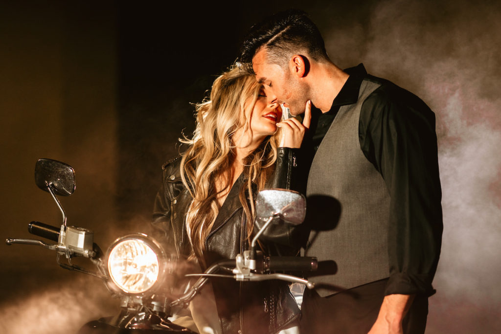 Urban and Edgy Bride in Leather Jacket with Groom in Black Dress Shirt and Gray Vest Intimate on Scooter | Tampa Bay Wedding Photographer Bonnie Newman Creative | Wedding Hair and Makeup Adore Bridal Services