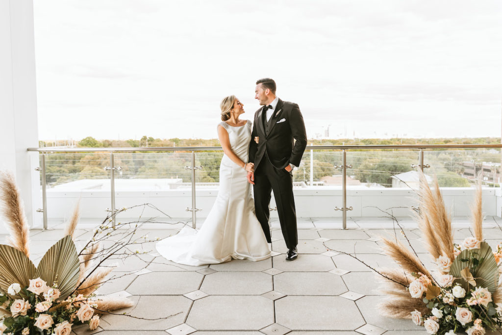 Organic Boho Modern White and Brown Rooftop Wedding Ceremony Flowers with Peach Roses, Gold Leaves, and Feathers | Tampa Bay Wedding Florist Monarch Events | Planner and Designer UNIQUE Weddings + Events | Venue Aloft/Element Midtown | Photographer and Videographer Bonnie Newman Creative