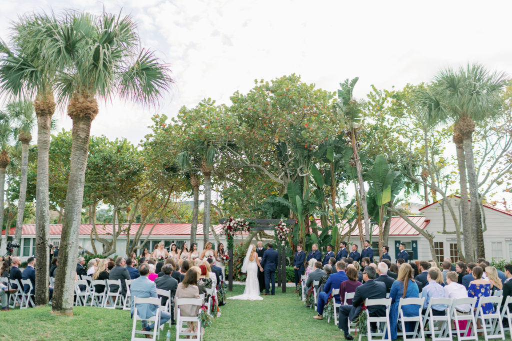 Tampa Bay Bride and Groom Exchanging Wedding Vows During Ceremony | Clearwater Wedding Venue Carlouel Beach and Yacht Club