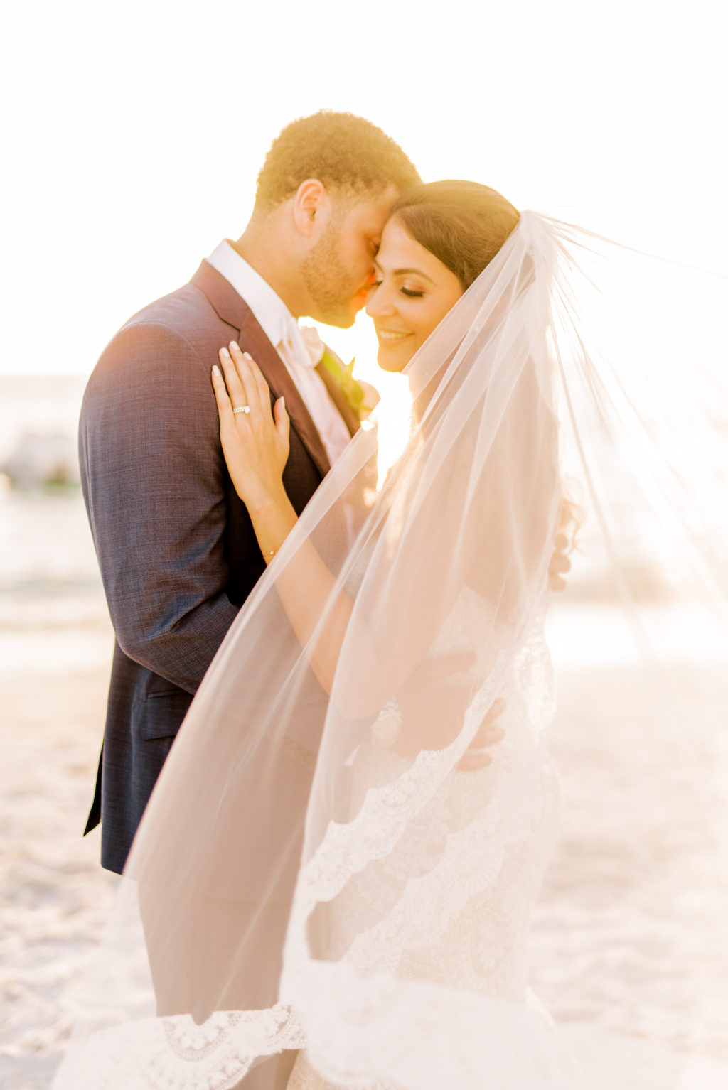 Sunset Bride in Full Length Veil and Groom Portrait on Beach | Tampa Bay Wedding Photographer Kera Photography
