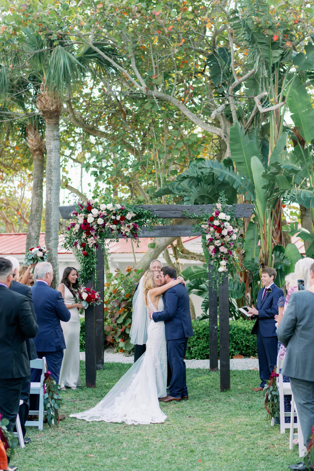 Tampa Bay Bride and Groom Exchanging Wedding Vows During Ceremony   Clearwater Wedding Venue Carlouel Beach and Yacht Club