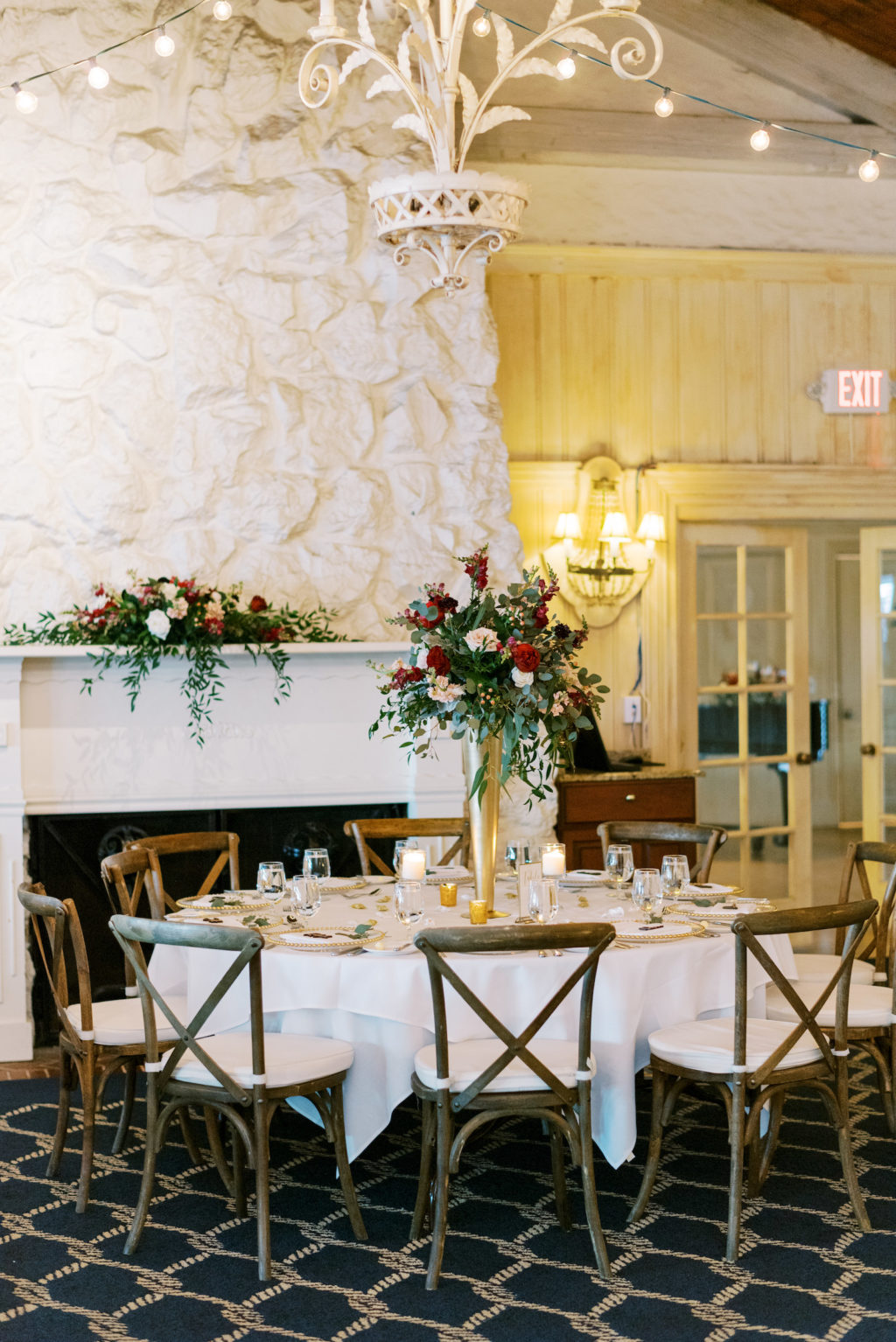 Rustic Romantic Wedding Reception Decor, Wooden Cross Back Chairs, Tall Gold Vase with Lush Red and White Roses and Greenery Floral Centerpiece   Tampa Bay Wedding Venue Carlouel Beach and Yacht Club   Wedding Rentals A Chair Affair