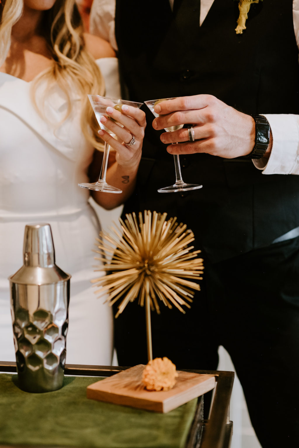 Retro Bride and Groom Cheering with Martini Cocktail at Bar Cart