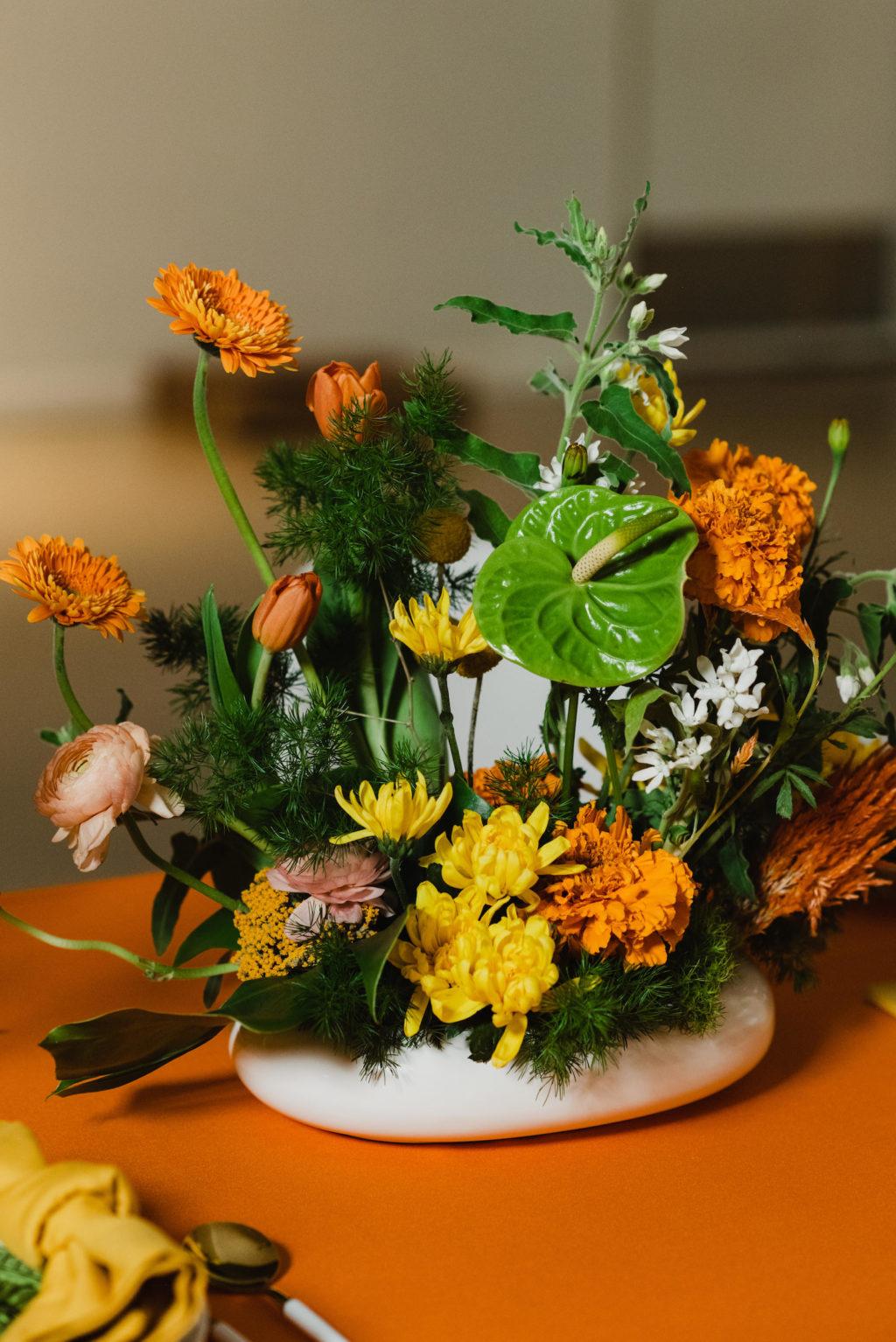 Retro Vibrant Flower Centerpiece Wedding Reception Decor, Yellow Florals, Orange Marigolds, Green Anthuriums