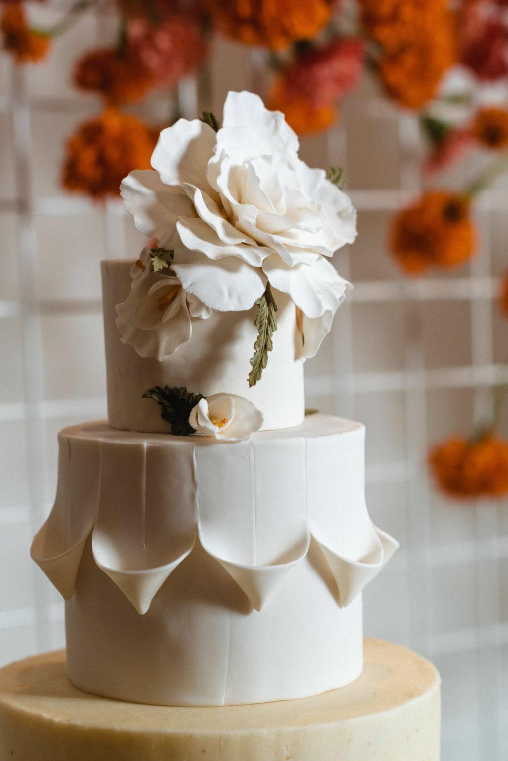 White Textured Wedding Cake with Sugar Flower Cake Topper