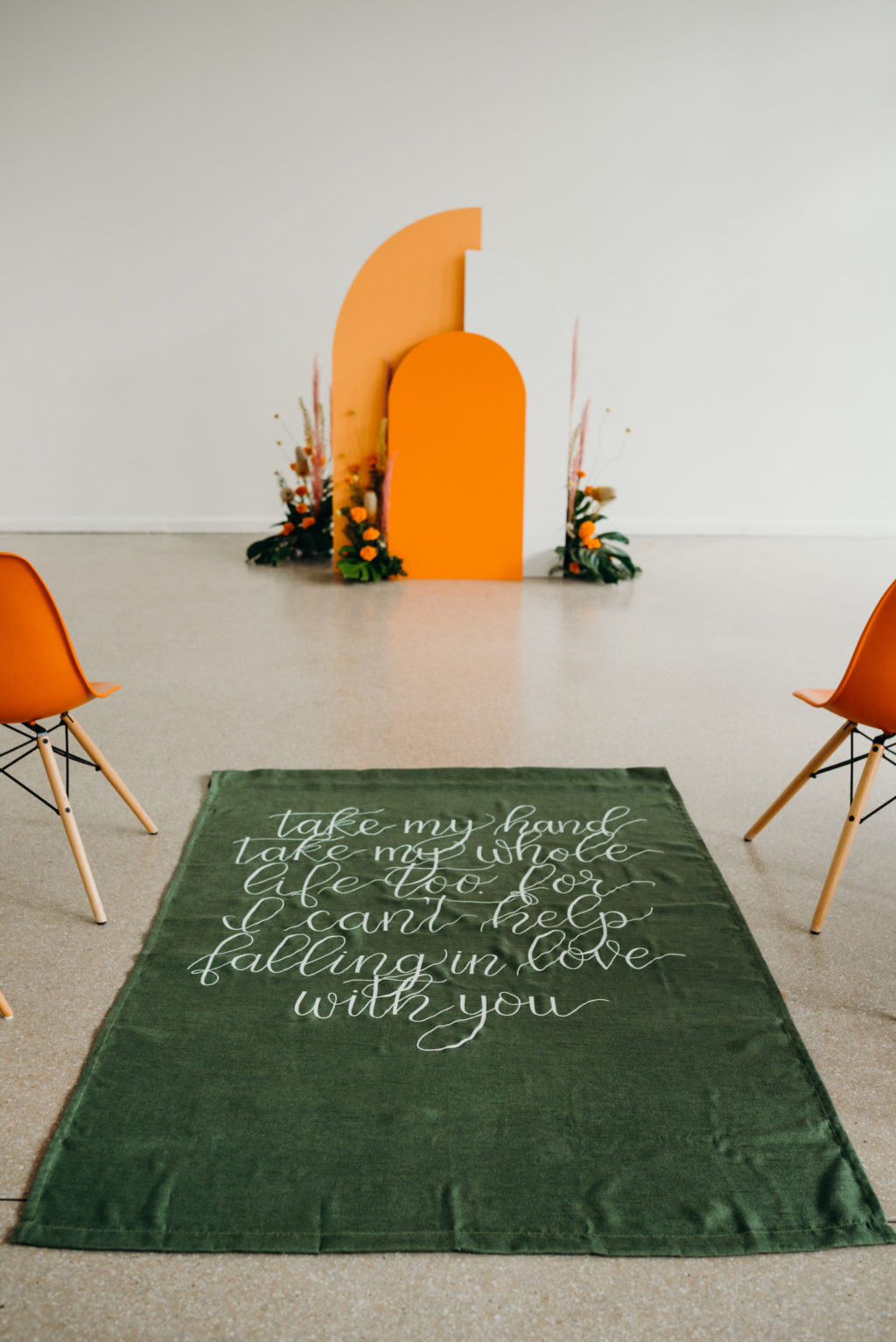 Retro Mid Century Modern Wedding Ceremony Decor, Orange and White Geometric Rounded White and Orange Arch, Green, Green Aisle Runner with White Script Font | Wedding Venue Tampa Garden Club