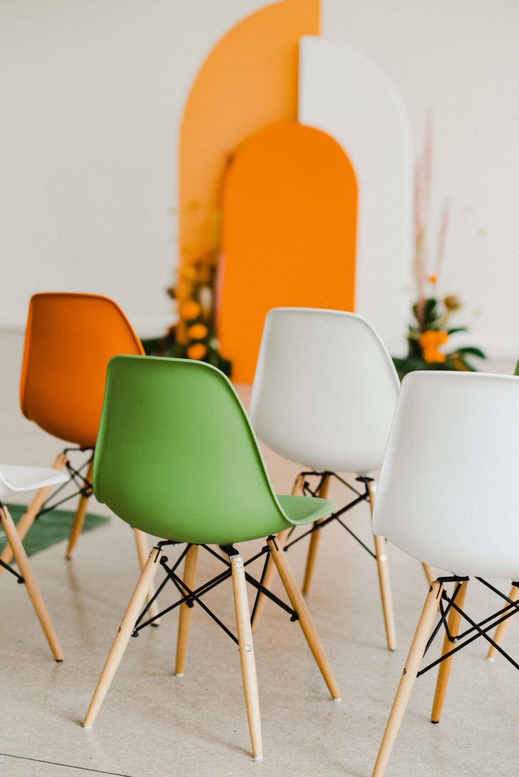 Vibrant Retro Mid Century Modern Wedding Ceremony Decor, Green, White and Orange Eames Chairs