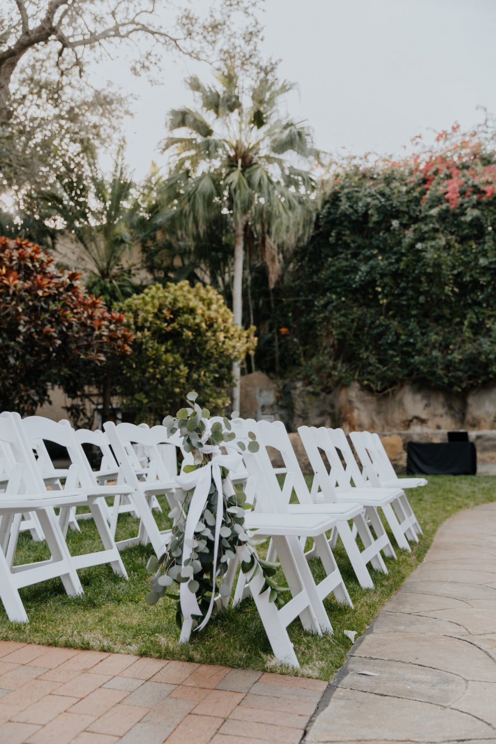 Downtown St. Petersburg Outdoor Wedding Ceremony with White Floral Bouquets and Greenery   Sunken Gardens