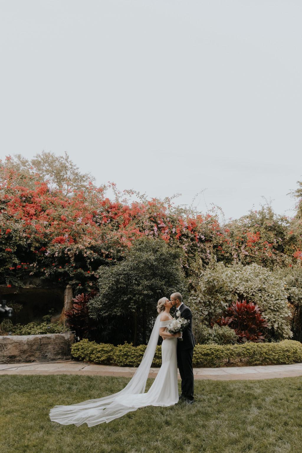 Outdoor Bride and Groom Embracing Wedding Portrait   St. Pete Garden Wedding