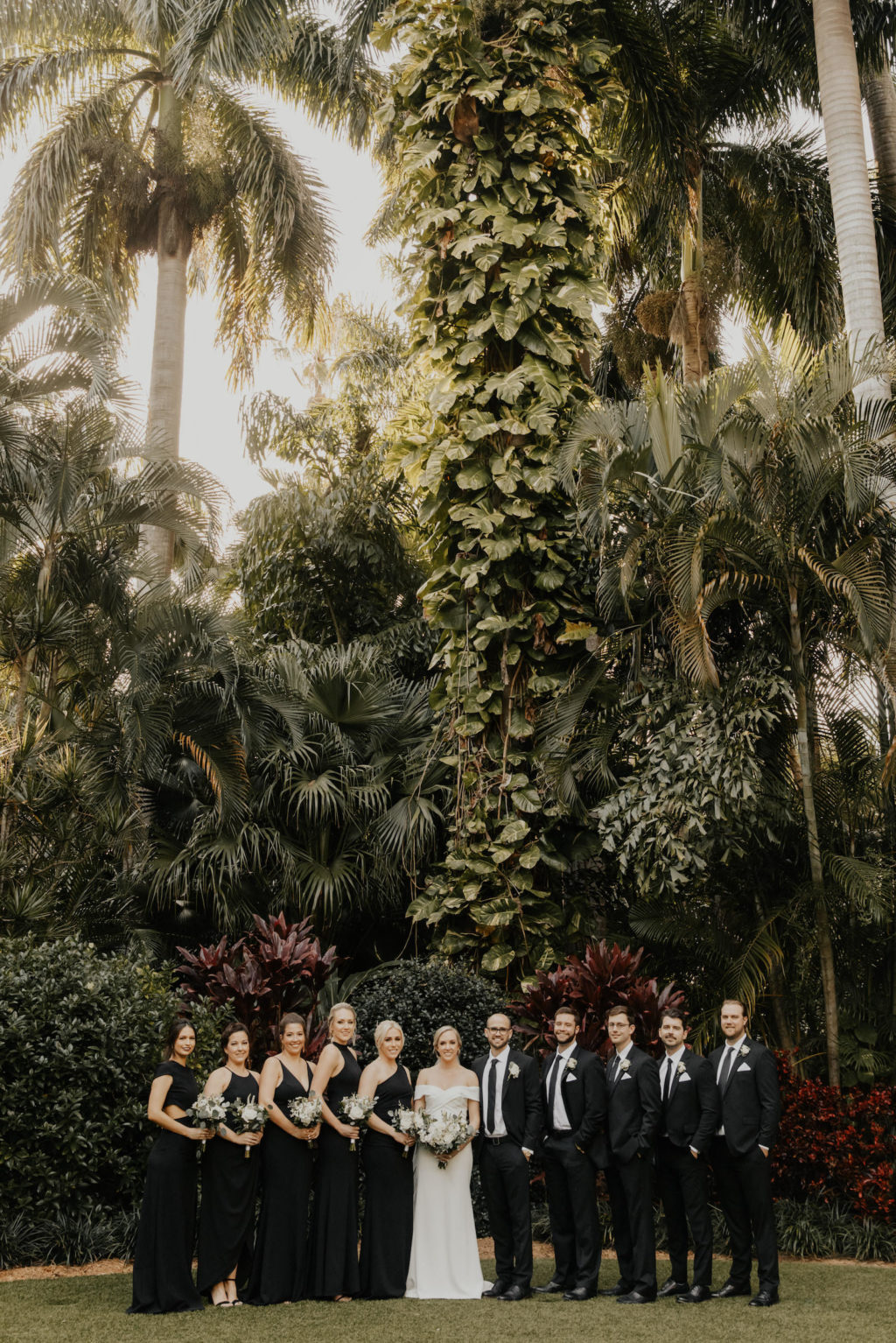 Classic Florida Wedding Party at Sunken Gardens in Downtown St. Petersburg, Brides Wearing Mix and Match Long Black BHLDN Bridesmaid Dresses, Groomsmen in Classic Black Suit and Tie   Tampa Bay Wedding Hair and Makeup Artist Femme Akoi Beauty Studios