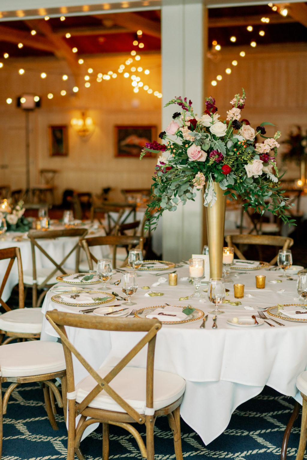 Rustic Romantic Wedding Reception Decor, Wooden Cross Back Chairs, Tall Gold Vase with White, Red, Blush Pink Roses, Greenery Floral Centerpiece   Tampa Bay Wedding Rentals A Chair Affair