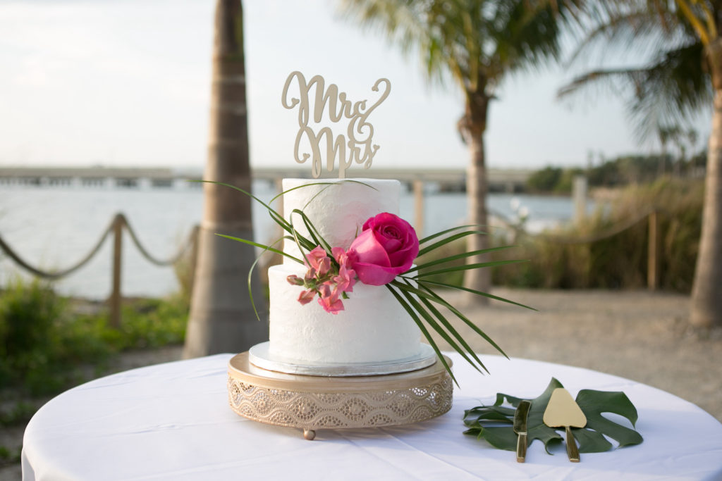 Modern Tropical Intimate Wedding Cake, Two Tier White Cake with Vibrant Pink Rose and Green Palms, Gold Cake Cutting Set on Monstera Leaf Table Decor, Mr and Mrs Wedding Topper, Boho Vintage Low Cake Stand | Florida Wedding Photographer Carrie Wildes Photography