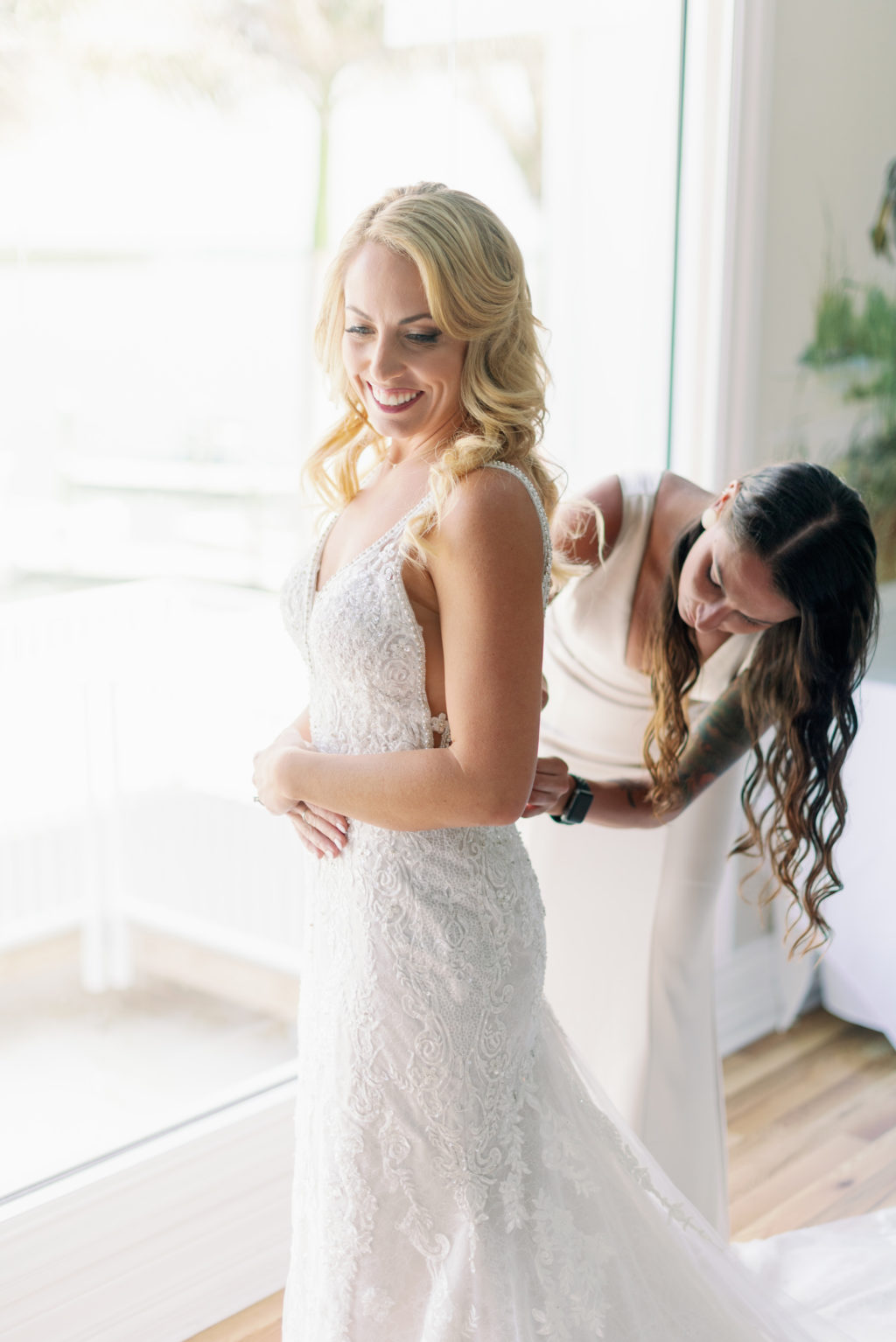 Tampa Bride Getting Wedding Ready in Lace Spaghetti Strap Wedding Dress   Wedding Hair and Makeup Michele Renee the Studio