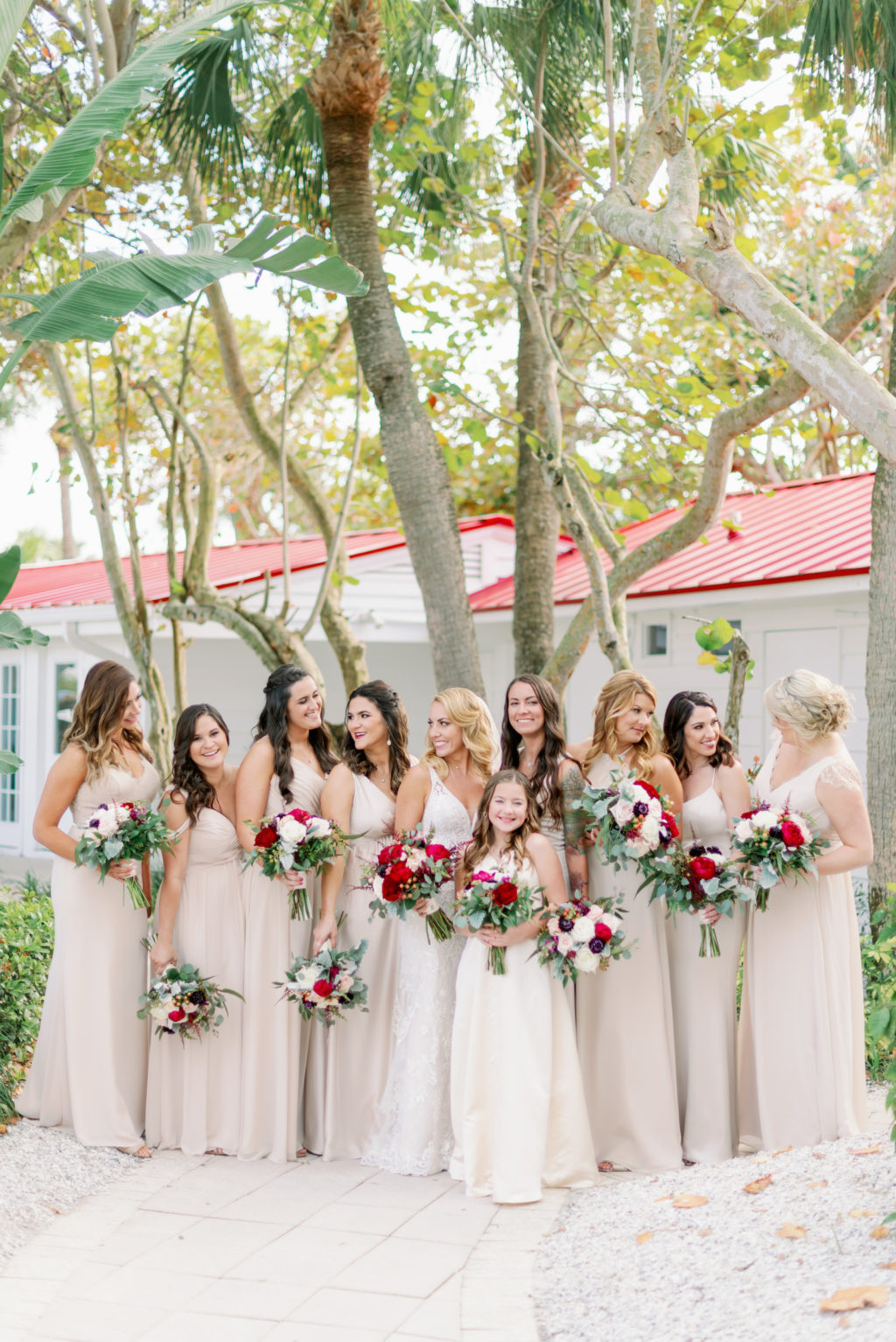 Tampa Bay Bride with Bridesmaids in Champagne Dresses Holding Colorful Red and Ivory with Greenery Floral Bouquets   Tampa Bay Wedding Hair and Makeup Michele Renee the Studio   Bridesmaids Dresses Bella Bridesmaids