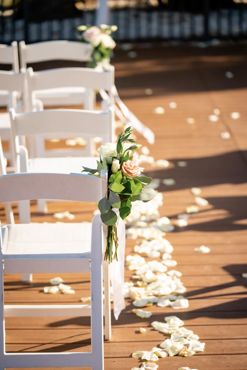 Mauve and Ivory Rose with Greenery Small Floral Arrangement on Folding White Chair for Wedding Ceremony Decor, White Flower Petals | Tampa Bay Wedding Florist Iza's Flowers