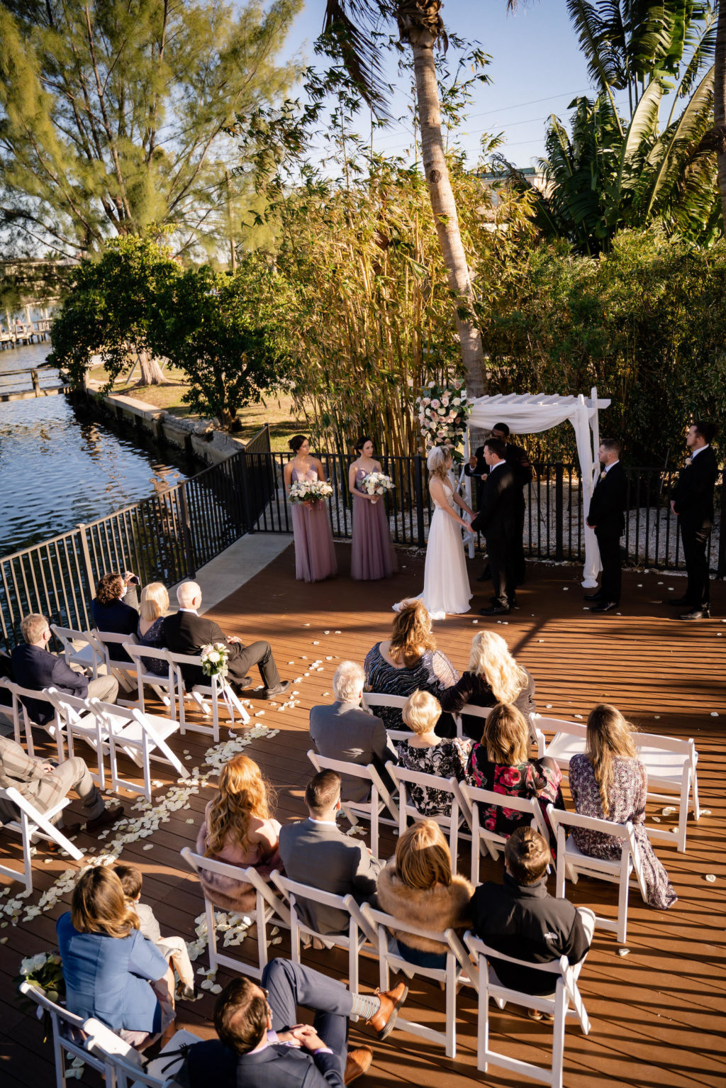Florida Bride and Groom Exchanging Wedding Vows During Outdoor Courtyard Ceremony | St. Pete Wedding Venue Hotel Zamora