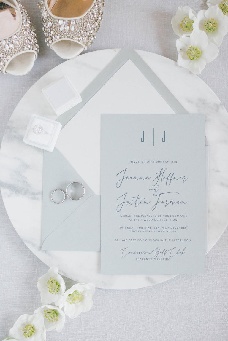 Classic Modern Powder Blue Wedding Invitation Suite and Wedding Rings on Round Marble Tray