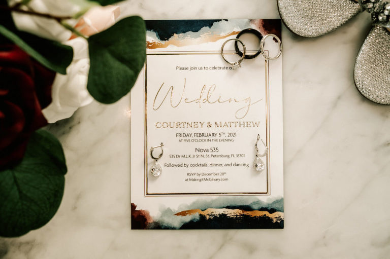 Industrial Inspired Wedding Invitation At NOVA 535 in Downtown St. Pete | Moody color palette with burgundy, navy and gold , with Wedding Bands and Diamond Tear Drop Florida Bridal Accessories