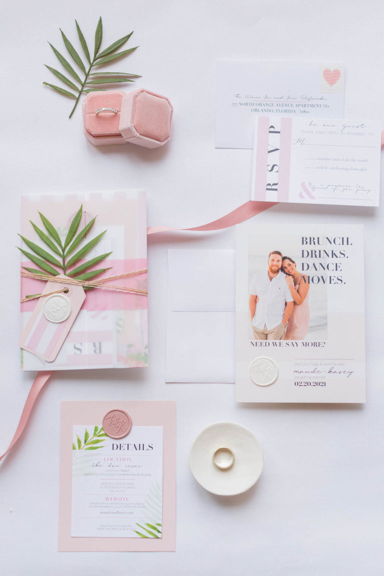 Florida Beach Wedding Invitation Suite Stationary Set Flat Lay with Tropical Greenery and Light Soft Blush Pink Wax Seal