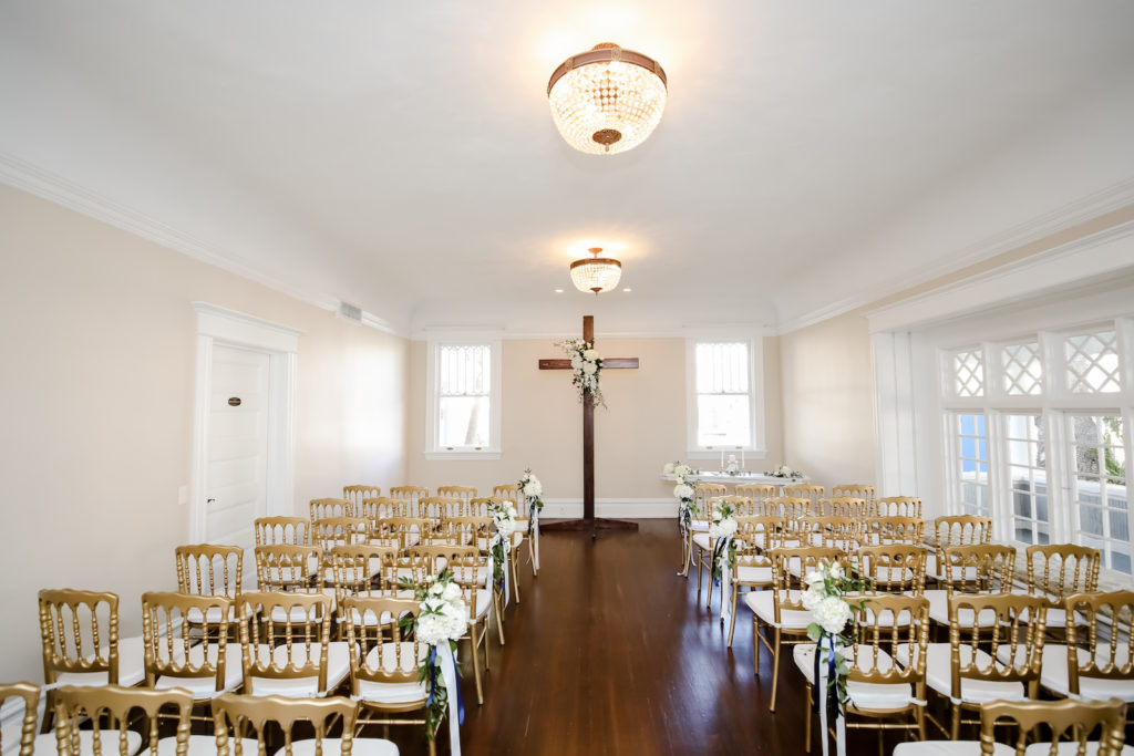 Classic Wedding Ceremony Decor, Wooden Cross at Altar, Gold Chairs with White Floral Bouquets | Tampa Bay Wedding Photographer Lifelong Photography Studio | Wedding Rentals A Chair Affair | Kate Ryan Event Rentals