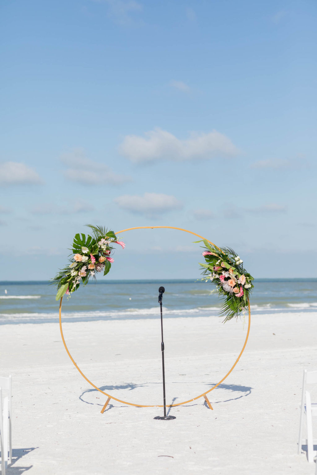 Beach Wedding Round Arch Beach Wedding Round Arch Floral Arrangement Spray | Tropical Wedding Flowers with Monstera Leaf Greenery, Peach Roses, White Anthurium, and Pink ProteaArrangement Spray | Tropical Wedding Bride and Bridesmaid Bouquets with Monstera Leaf Greenery, Peach Roses, White Anthurium, and Pink Protea