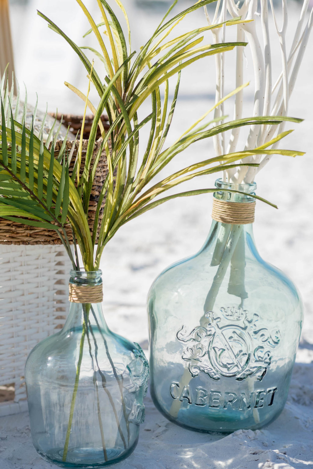 St. Pete Beach Wedding Aisle Flower Arrangement Centerpieces Recycled Glass Bottles with Palm Greenery