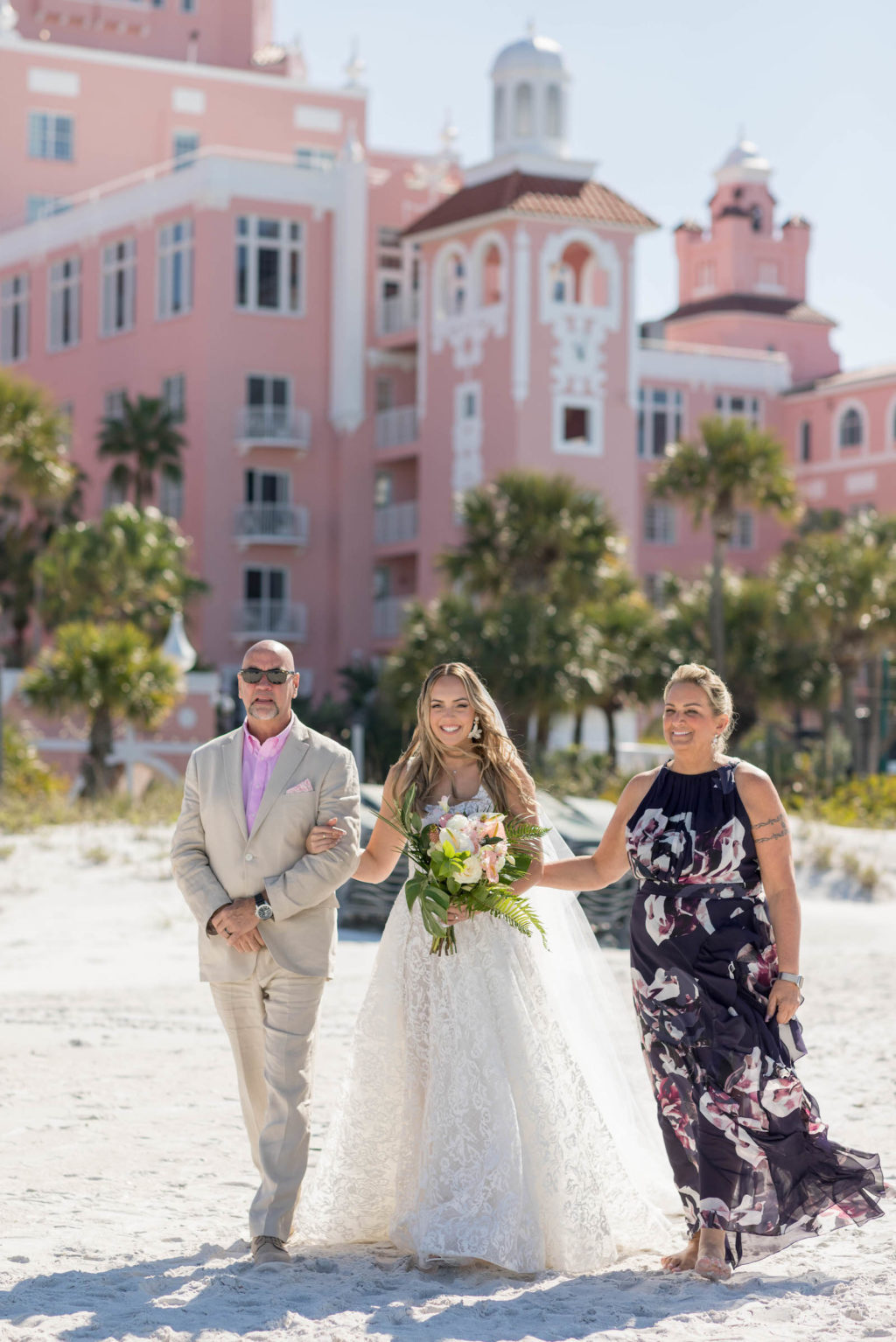 Bride Walking Down the Aisle during Outdoor Beach Ceremony at St. Pete Beach Wedding Venue The Don CeSar Pink Palace | Monique Lhuillier Designer Wedding Dress A Line Ballgown Lace Bridal Gown