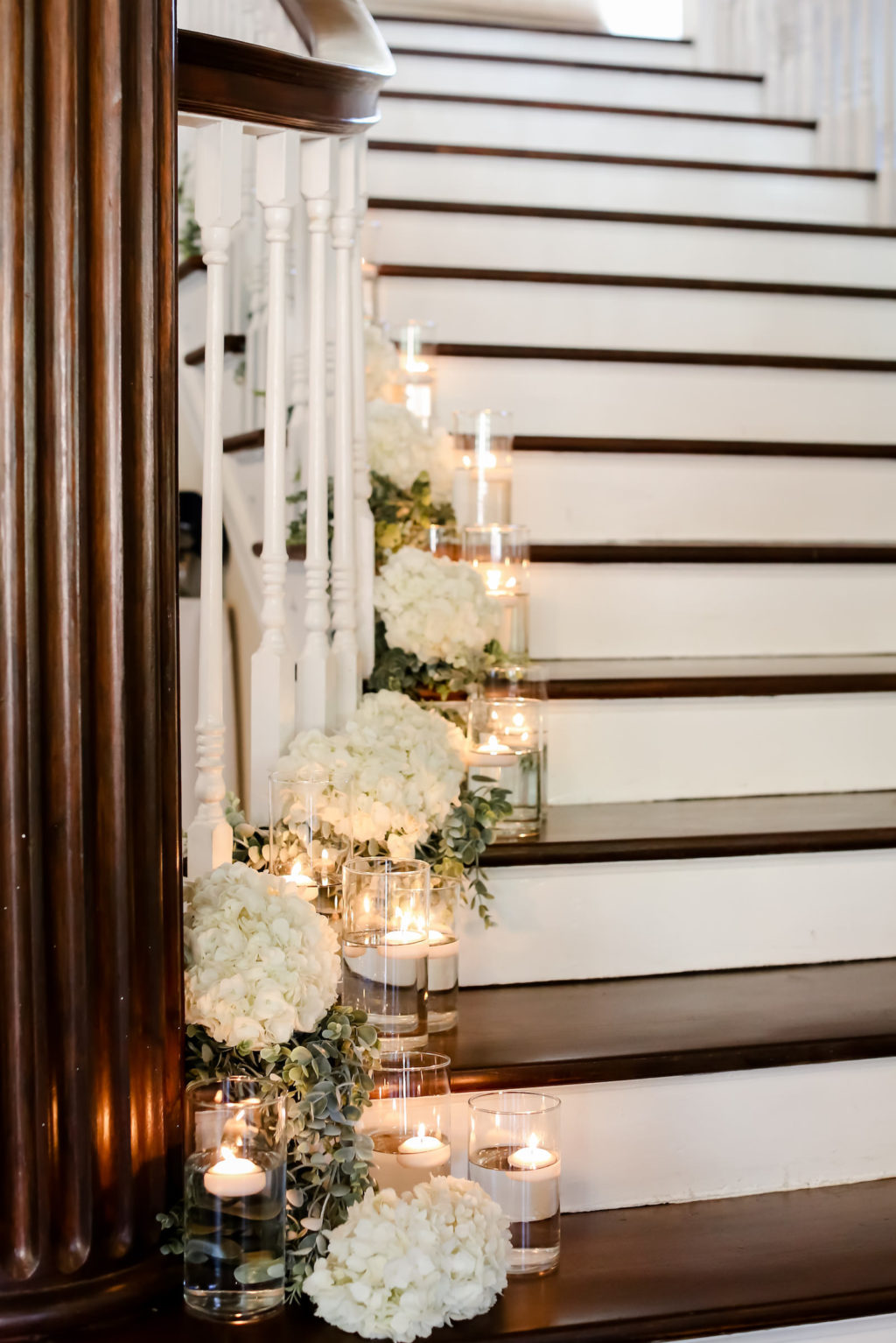 Classic Wedding Decor, Staircase Lined with Floating Candles, White Hydrangea Floral Arrangements | Tampa Bay Wedding Photographer Lifelong Photography Studio | Wedding Planner Core Concepts
